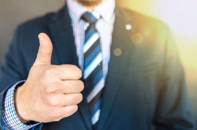 close up photo of man wearing black suit jacket doing thumbs 684385 Frequently Asked Questions about Music Production